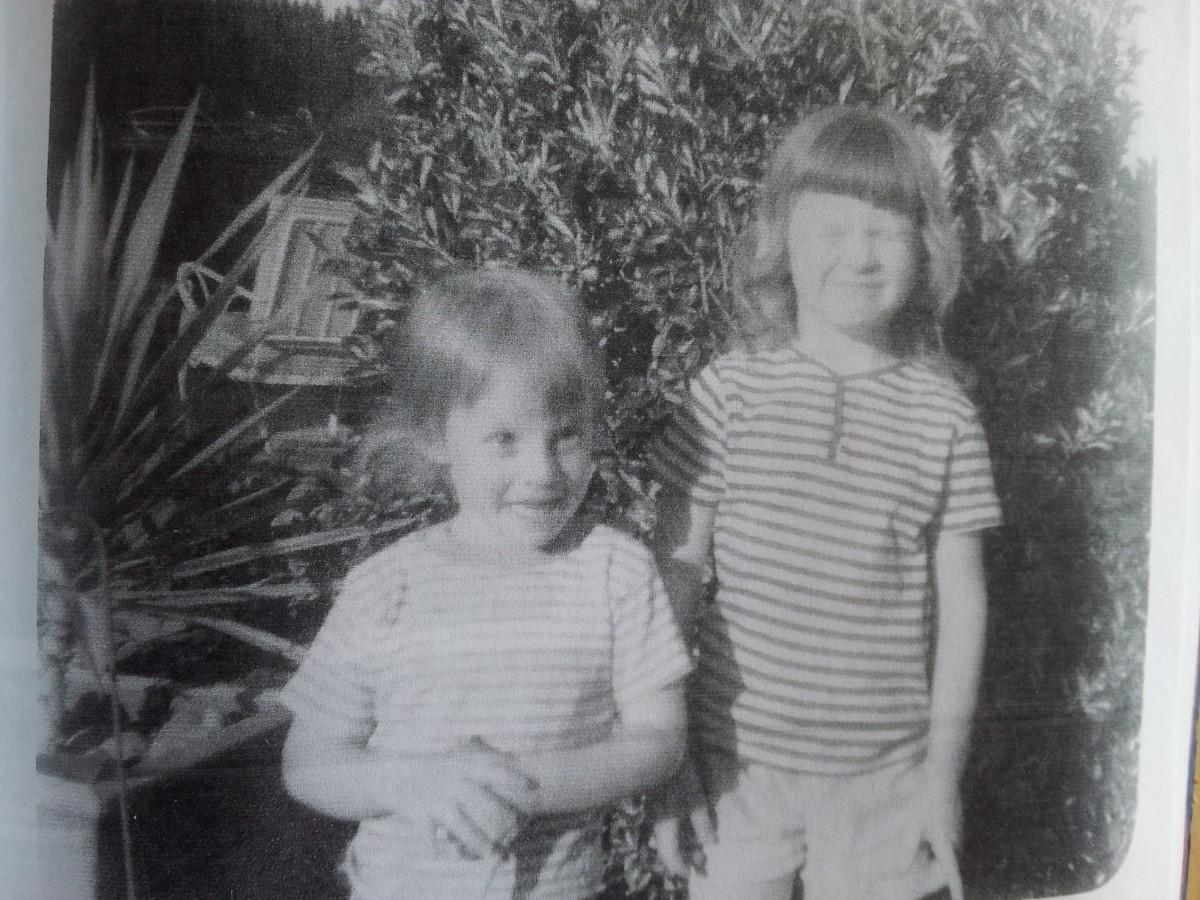 Black & white photo of two little girls wearing t-shirts and shorts